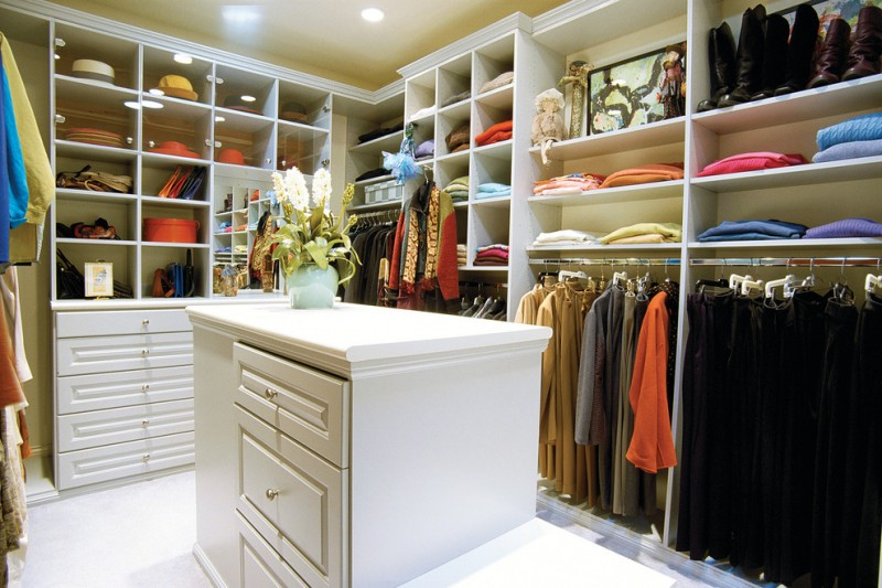 large white melamine walk in closet with white melamine center island with extra drawer system