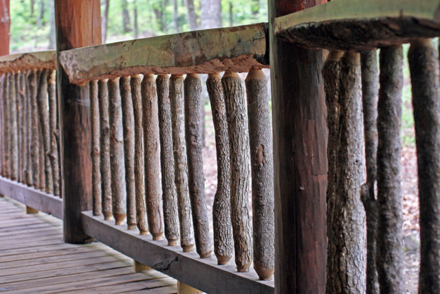 log railings idea which is made of smaller logs and frammed with hardwood