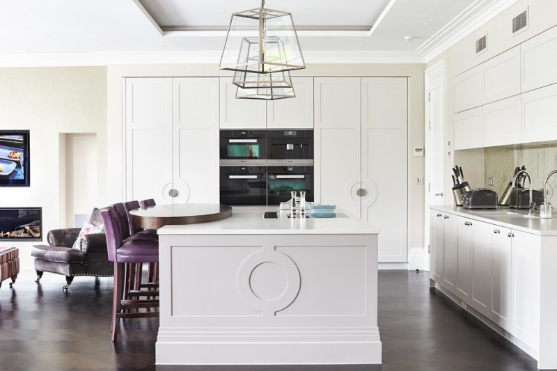 luxurious eat in kitchen idea with pop purple bar stools large white island built in walk in closet storage stainless steel appliances built in cabinets in white white countertop
