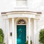 luxurious house door design blue flowers pathway pot pillars white wall window grass luxurious house
