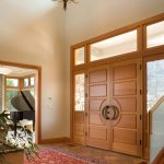 luxurious house door design carpet glass wood hanging chandelier piano plant wooden door luxury