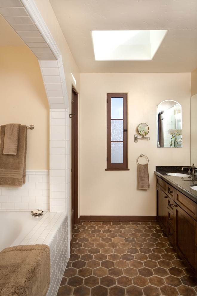 mediterranean bathroom idea terracota floors in hexagon shape dark toned wooden vanity with double vessel sinks white ceramic tiles for bathtub's walls and floors