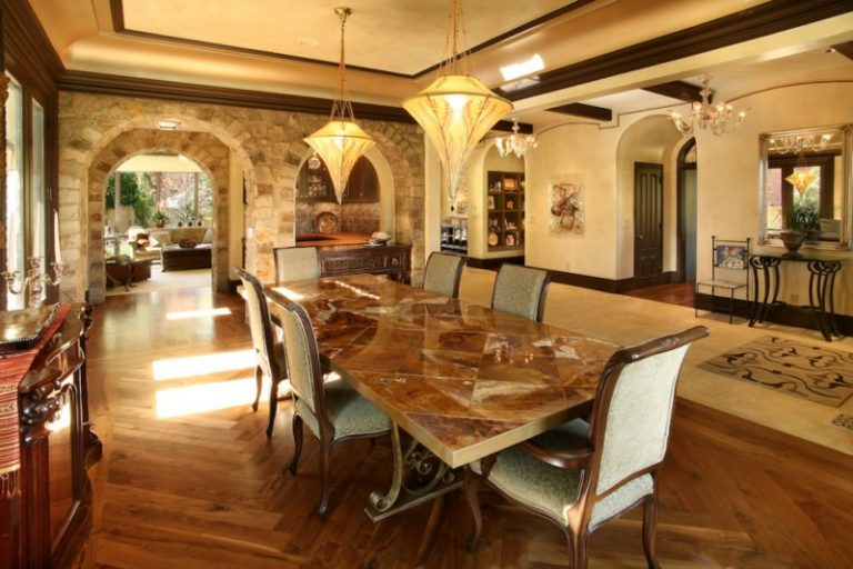 Mediterranean Dining Room With Wooden Flooring Earthy Color Wall And Ceiling Stones Arch