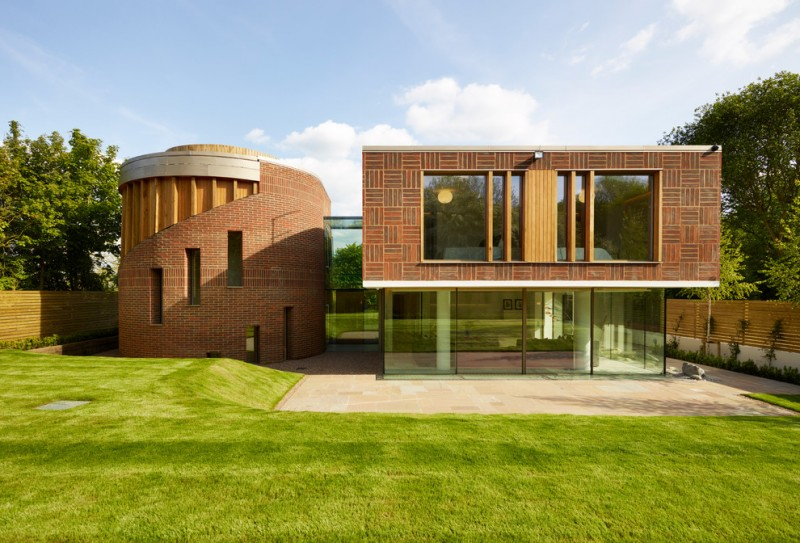 modern brick exterior house with multi designs exterior windows and full glass walls under main construction