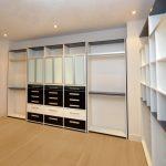 Modern Custom Walk In Closet In Monochromatic Color Light Wood Color Flooring System