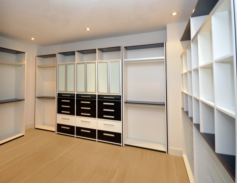 modern custom walk in closet in monochromatic color light wood color flooring system