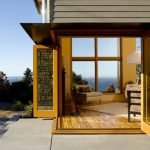 modern glass and wooden bi fold patio door