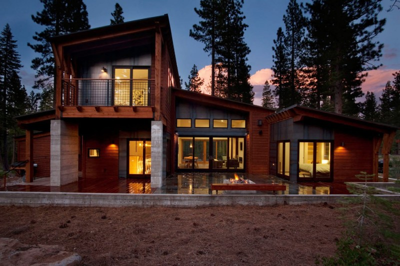 modern mountain house with stone exterior walls in first floor and stone in the second floor, sleek angled roof