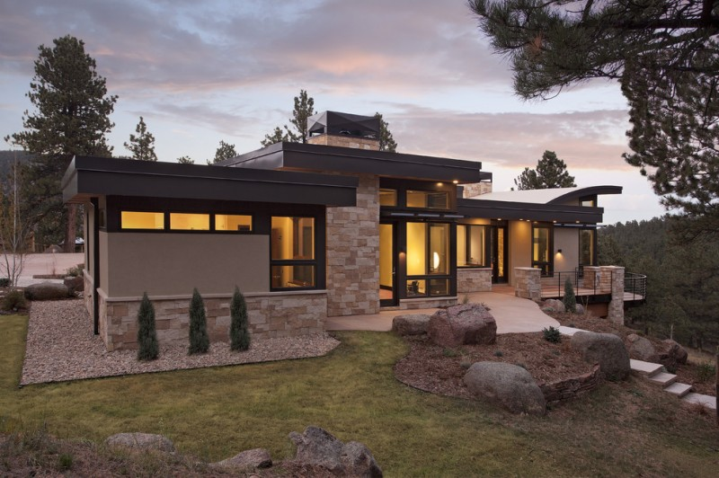 modern mountain house with stone wall exterior, arched roof, window wall