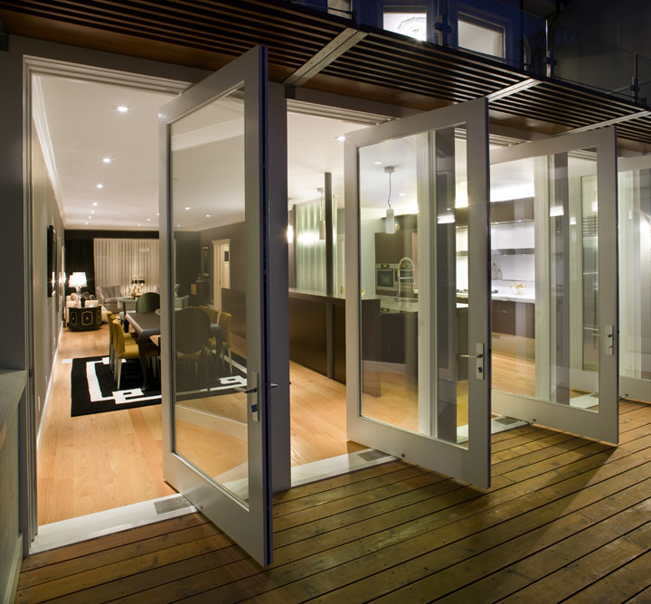 modern pivot glass patio doors with white wooden frame