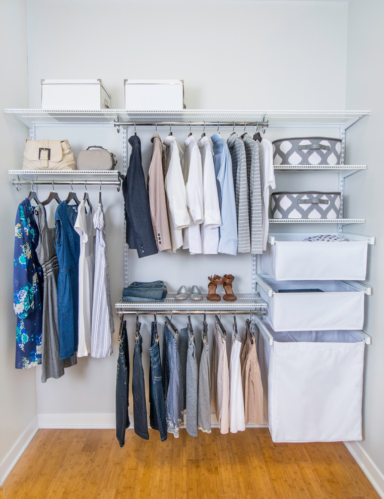 modern walk in closet in small size which consists of slide out shoes rack canvas baskets pants hang section shirts hang section dress hang section handbag rack