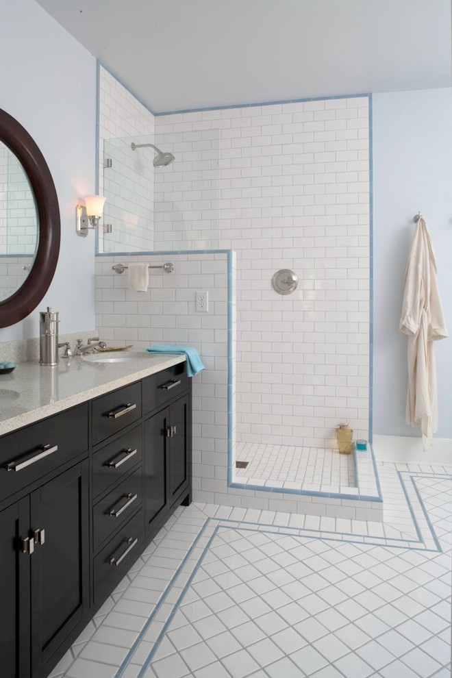 most updated doorless walk in shower with white subway tiles for floors and walls bathroom vanity with white countertop black cabinets double undermount sinks and black framed round mirror
