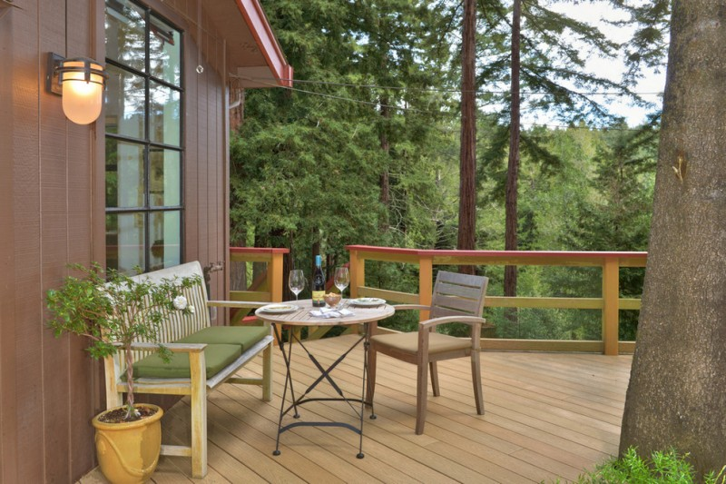 mountain style deck idea with simple minimalist wooden rail system a set of outdoor furniture dark brown exterior siding walls