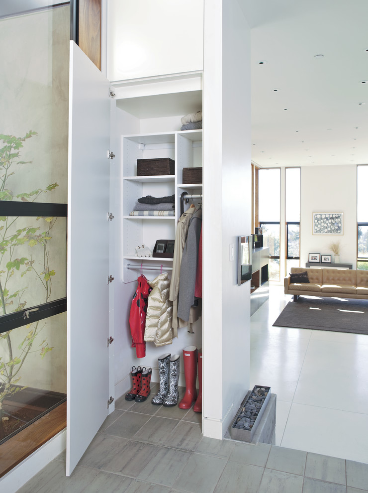 narrow and vertical walk in closet idea in mud room