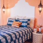 Navy Blue Bed Sheet Idea With Mdoern Patterns Orange Walls Higlighted By White Hand Painted Headboard Rounded Top Side Table In White A Couple Of Classic Single Pendant Lamps