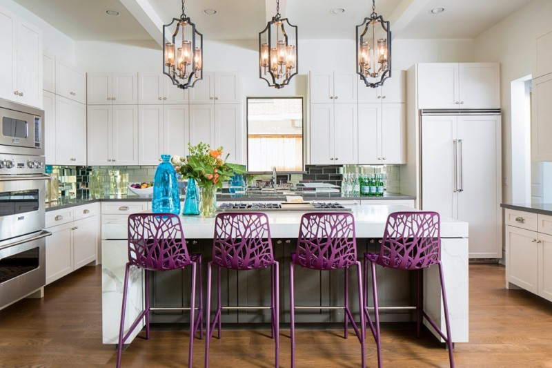open concept kitchen design with white cabinets white appliances white island and mini bar black subway tiles backsplash wood color floors purple stools