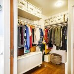 Pocket Door With Small Walk In Closet Dark Wood Floors Some Basket Storage