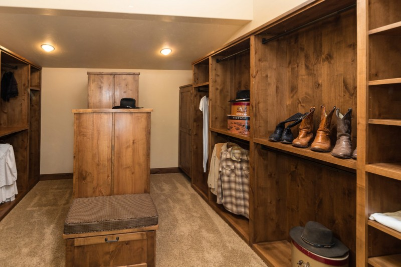 Raw Rustic Walk In Closet Idea With Taller Island And Chair At Center  Western Design Intl