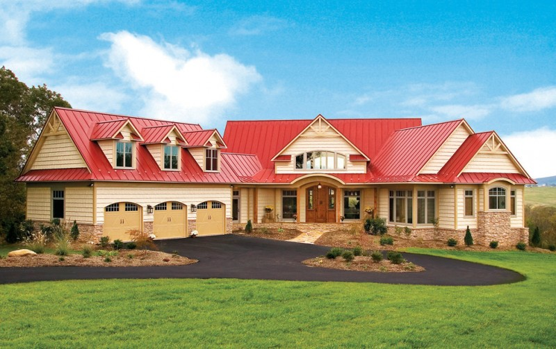 red metal roof stone wall three garage wooden trim beige trim wooden door arched windows