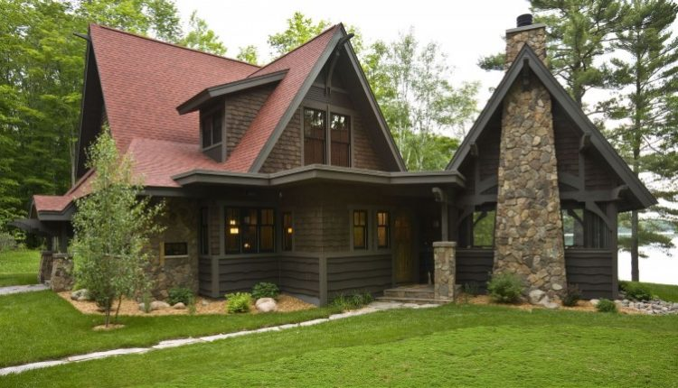 red roof brick wall dark wooden wall stone chimney green outdoor view