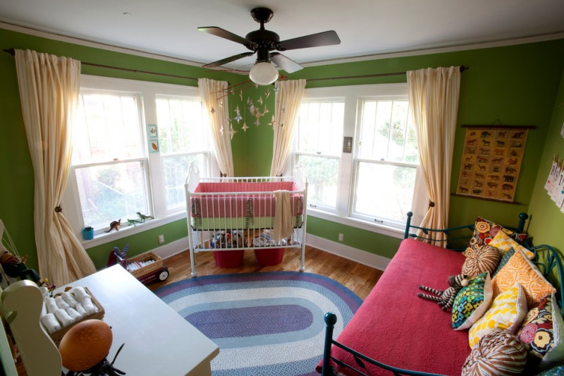 room decor with toy carpet wood windows curtains seating table pillows toys green red ceiling fan