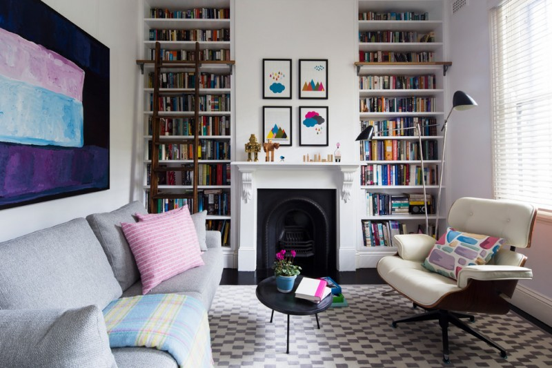 room decor with toy floor patterns seating sofa pillows wall decor bookshelves window books lamps toys