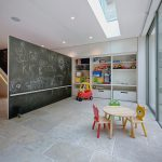 room decor with toy small chairs table shelves toys glass floor tile ceiling wall light and dark colors