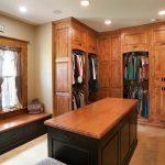 Rustic Walk In Closet Idea In Log Home