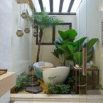 safari bedroom with plants, soile in the bathtub area with wood step, white flooring in the sink area, white bathtub,