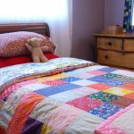 Shabby And Chic Bedroom Idea With Colorful Quilt Wooden Bed With Headboard Old And Bedroom Vanity With Mirror