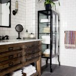 Shabby White Subway Tiles Walls Dove Black Ceramic Tiles Floors With Thin Grouts Rustic Woodencabinets White Marble Countertop Undermount Sink Black Storage With Glass Panels