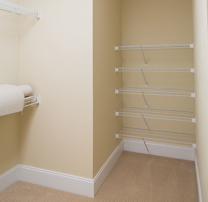 simple small closet organizer with shelves supported by white metal stands
