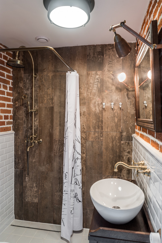 small bathroom with white tiles half down and orange tiles half top wall, one brwon tiles side wall, golden shower head, white curtain, white sink, golden faucet, wood vanities,