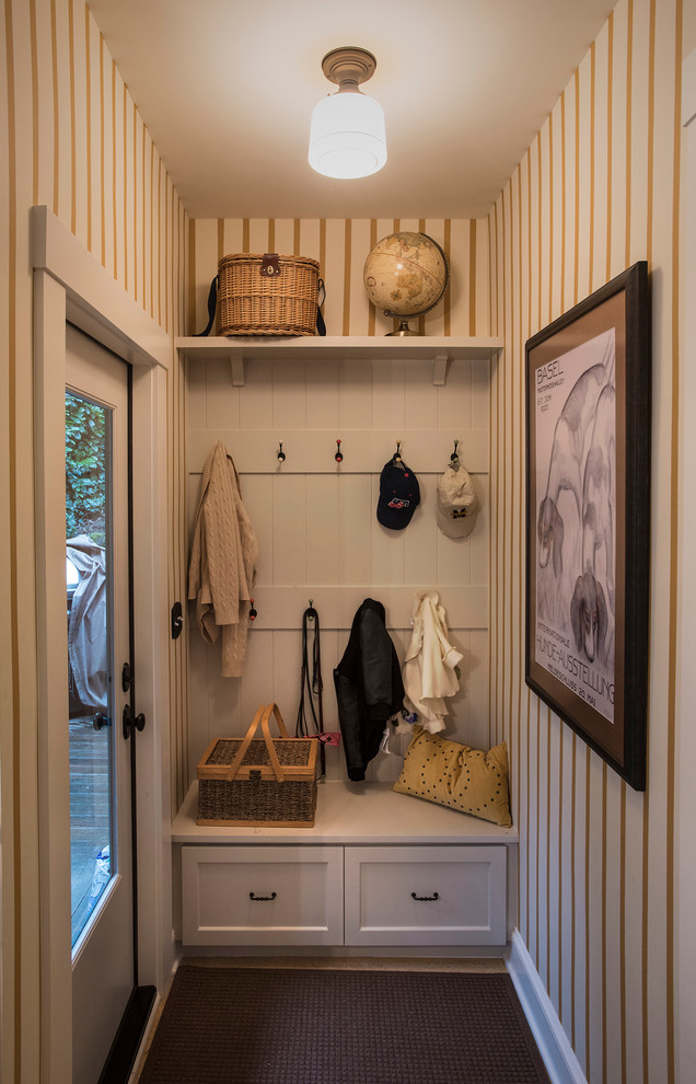 small entrance with white wooden storage under hanging area