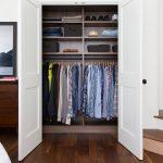 Small Reach In Closet With Door Panels Dark Toned Wooden Floors