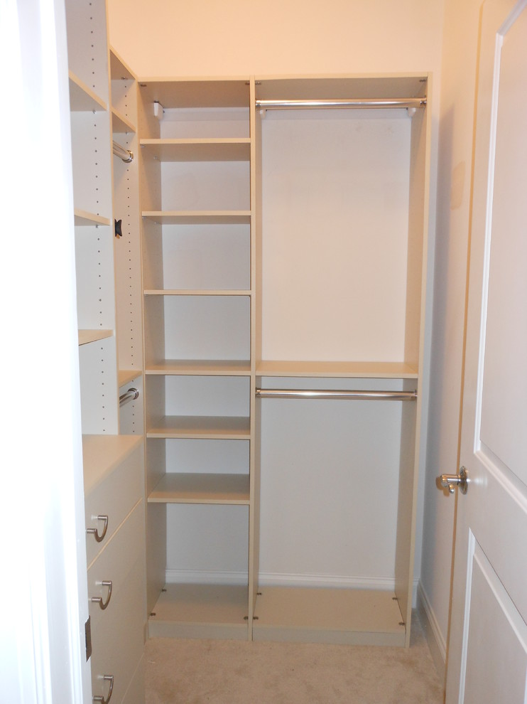 small walk in closet design in small size and in white finishing