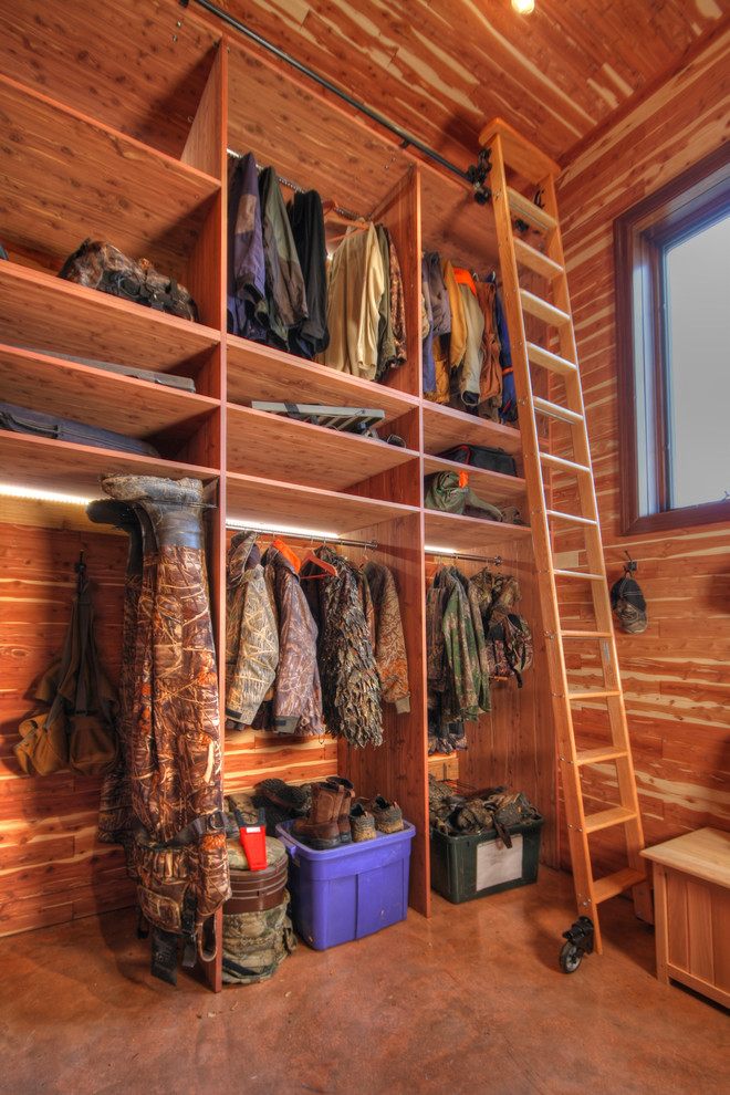 small walk in closet in garage with movable ladder addition