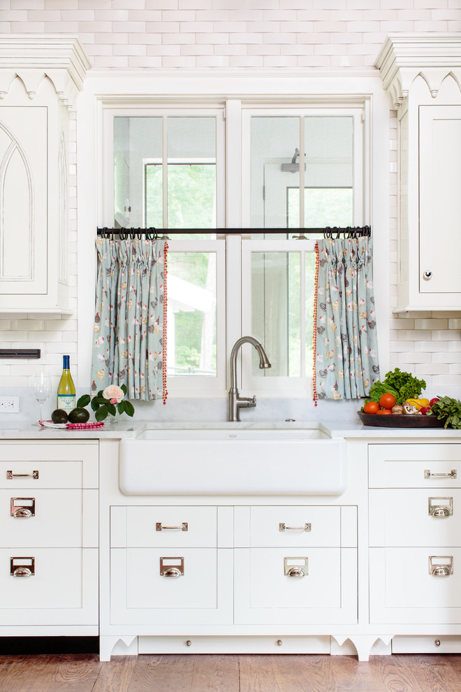 soft blue cafe curtains idea with multicolor motifs black wrought iron rod white farmhouse sink white kitchen cabinetry white subtle tiles backsplash