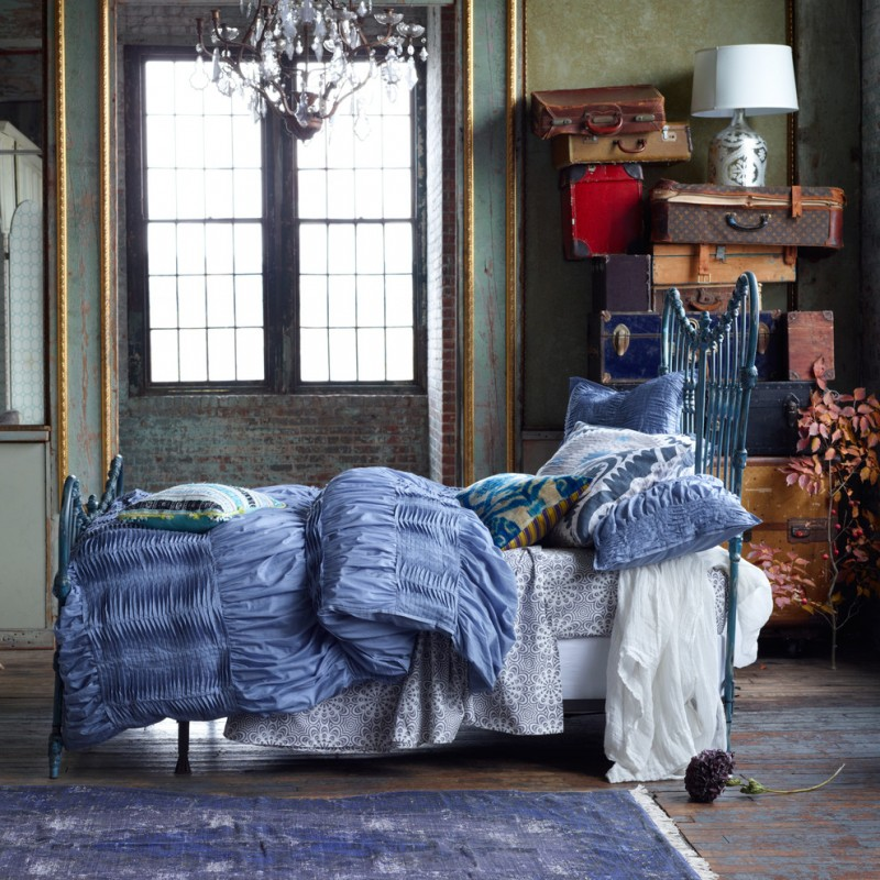 textured blue comforter grey bed sheet with classic motif blue painted bed with headboard shabby green walls shabby red brick walls shabby floors with blue area rug classic pendant lamp