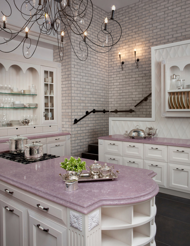 traditional kitchen idea with lavender quartz countertop flat panel cabinets in white white backsplash open shelves on counter's top