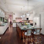 Traditional Kitchen Remodel With Purple Flowers Wallpaper Granite Countertop White Cabinets Dark Wood Floors Wood Stools Granite Top Kitchen Island Stainless Steel Appliances