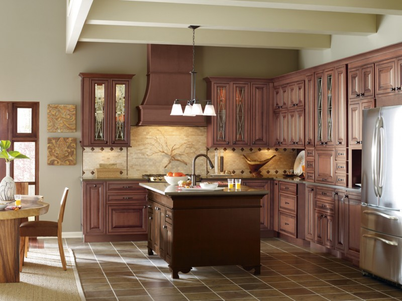 traditional kitchen with dark floor, dark wood cabinet, dark wood island, white pendant