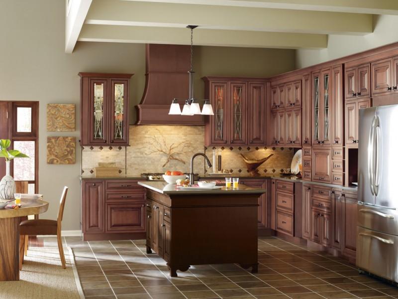 traditional kitchen with dark floor, dark wood cabinet, dark wood island, white pendant