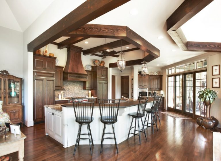 Traditional Kitchen With Dark Floor, White Island With Dark Wood Counter  Top, Dark Wood