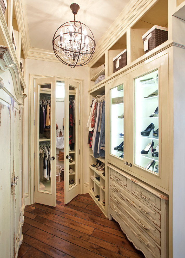 traditional rustic walk in closet organizer including glass door shoes shelves hanging sections upper open shelves dark wood flooring idea