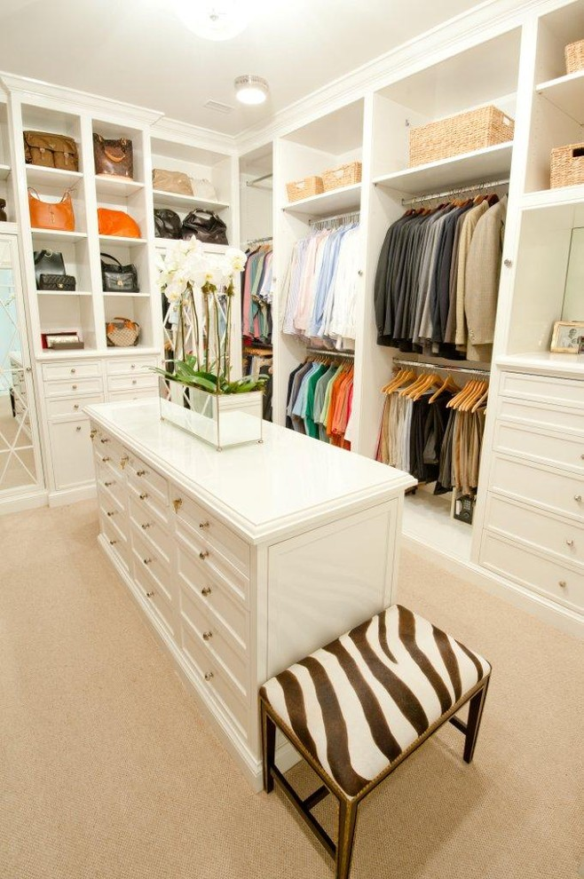 traditional walk in closet organizer in white with large white center table and animal printed chair