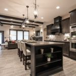 transitional kitchen with grey wood floor, dark wood cabinet, dark wood island,