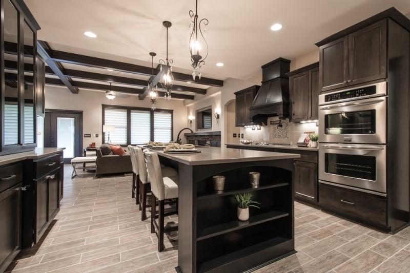 transitional kitchen with grey wood floor, dark wood cabinet, dark wood island,