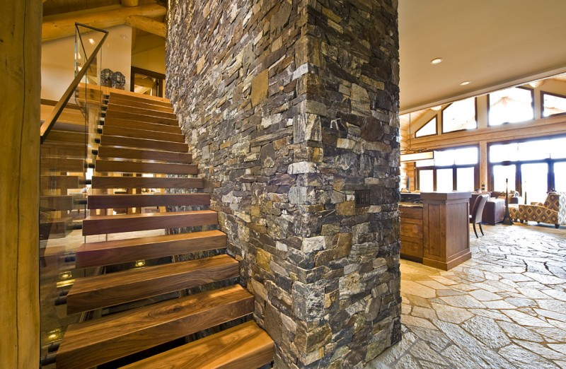 two floor stone and log house stairs stone floor stones glass sofas ceiling lamp logs rustic style staircase