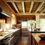 Two Floor Stone And Log House Stove Wood Floor Drawers Cabinets Lighting Faucet Sink Logs Stones Kitchen